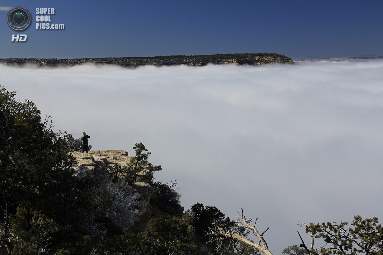 A rare total cloud inversion is pictured from the Yavapai Geology Museum on the South Rim of the Grand Canyon National Park in Grand Canyon, Arizona