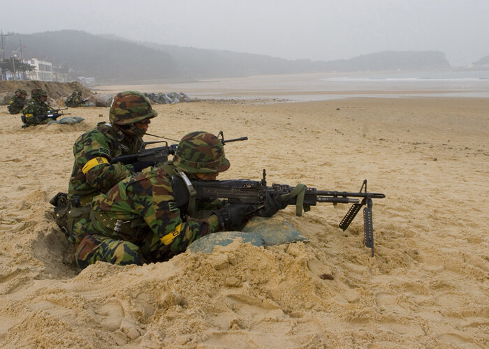 Republic of Korea soldiers portray simulated aggressors during an amphibious landing exercise involving ROK Marines and the 31st Marine Expeditionary Unit here, March 29, as part of Exercise Foal Eagle 07. The amphibious landing was conducted to provide t