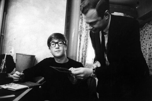 ENGLAND. 1963. John LENNON with manager Brian EPSTEIN