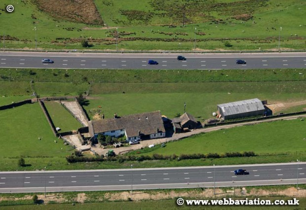 aerial photograph of Stott Hall Farm in the middle of the M62 motorway at Windy Hill