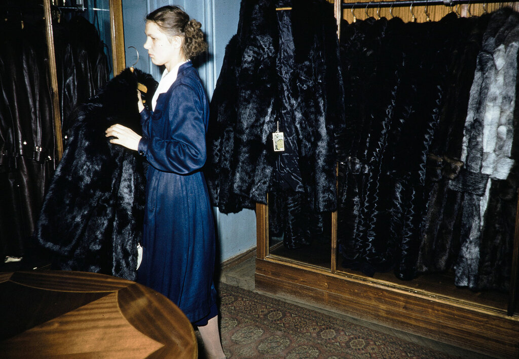 Russia, clerk selling fur coats at store in Moscow