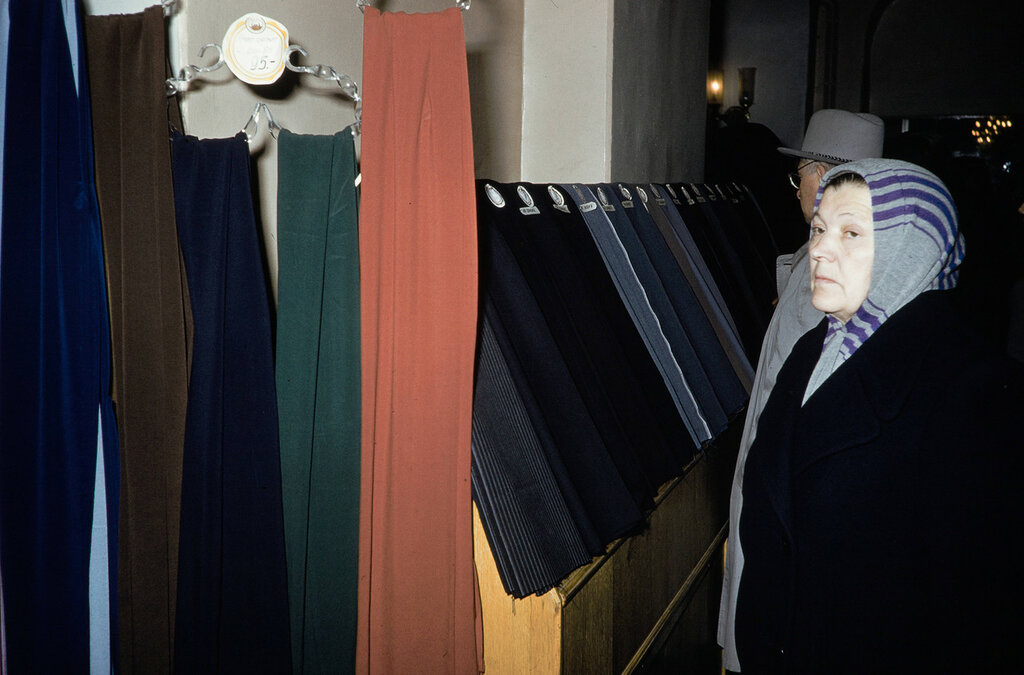 Russia, woman looking at fabric for sale at store in Moscow