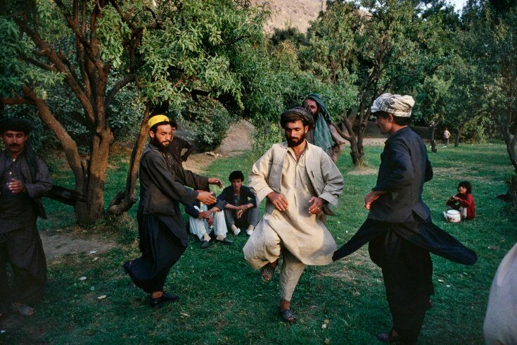 05.1_77: September, 1991 Afghan men in Kabul's Babur Gardens perform an attan dance, the traditional Afghan dance, during a Friday picnic.