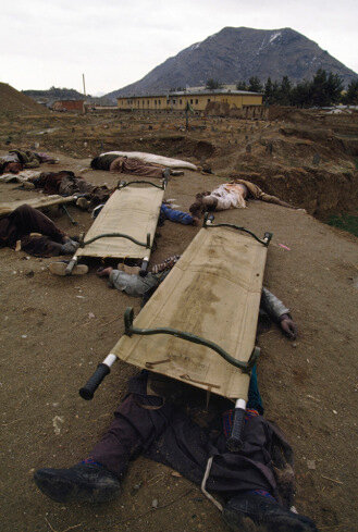 Sec2_afghanistan_02_64-Edit_print: March, 1993 Bodies of dead Hezb-i Wahdat Shia fighters are dumped on the ground in western Kabul, presumably killed by opposition Sunni fighters. Hundreds of ethnic Hazara Shiite civilians were killed by government facti