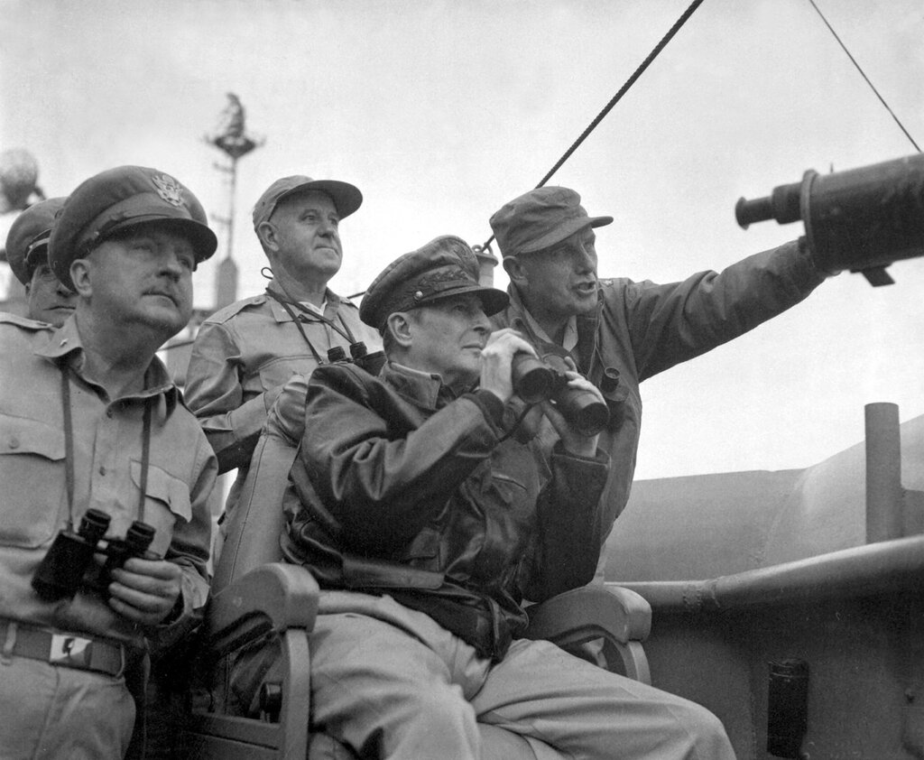 General Douglas MacArthur observes the naval shelling of Incheon from the USS Mt. McKinley, 15 September 1950