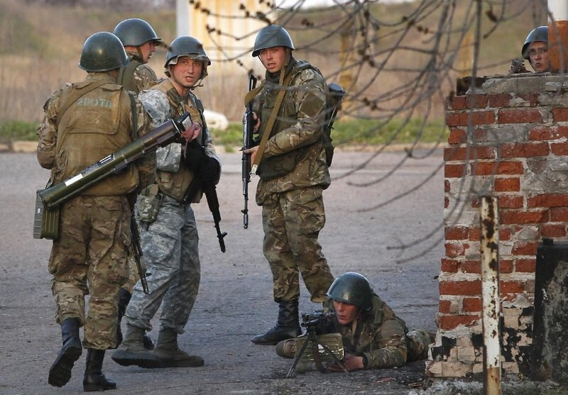 Ukrainian army troops set up a position at an airport in Kramatorsk, eastern Ukraine, Tuesday, April 15, 2014. In the first Ukrainian military action against a pro-Russian uprising in the east, government forces clashed Tuesday with about 30 armed gunmen