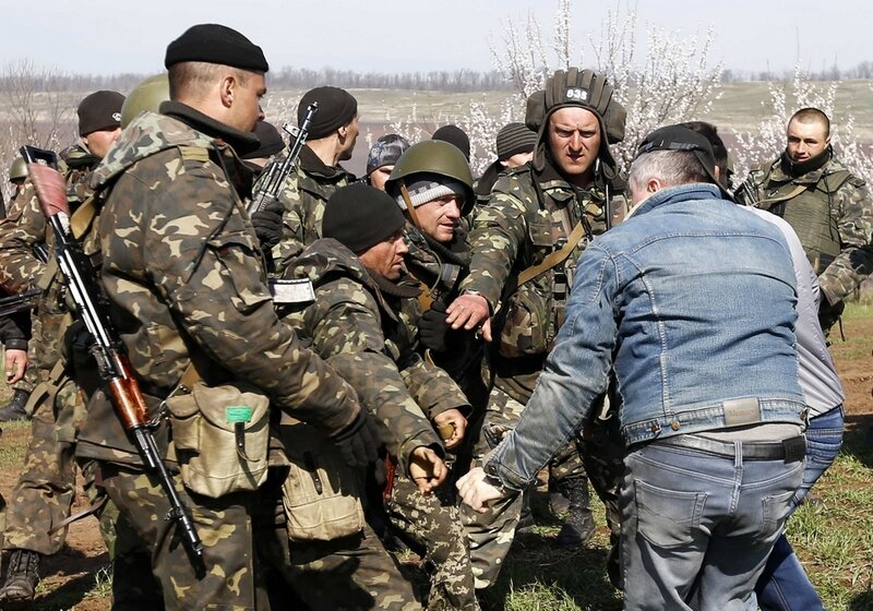 Ukrainian soldiers clash with pro-Russia protesters in a field near Kramatorsk