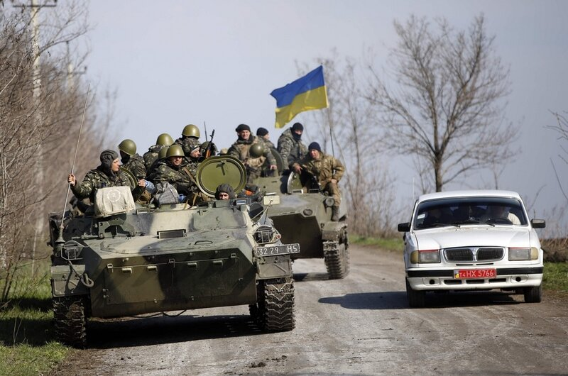 Ukrainian soldiers drive on an airborne combat vehicle near Kramatorsk
