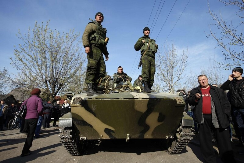 Ukrainian soldiers stand on an airborne combat vehicle in Kramatorsk