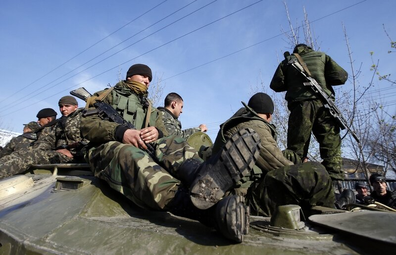 Ukrainian soldiers sit on an airborne combat vehicle in Kramatorsk