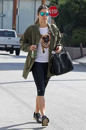 EXCLUSIVE: Nikki Reed wears a shirt with a pug wearing oversized glasses as she drinks a healthy green juice on the way into the gym