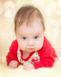 4 months old baby girl on a glitter bokeh background