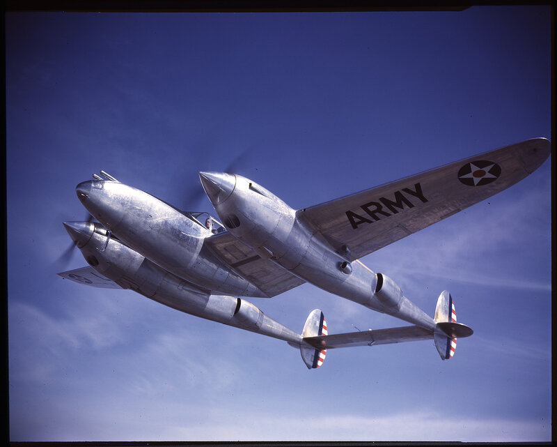 One-half left front view from slightly below of Lockheed YP-38 Lightning (s/n 39-692) in flight.