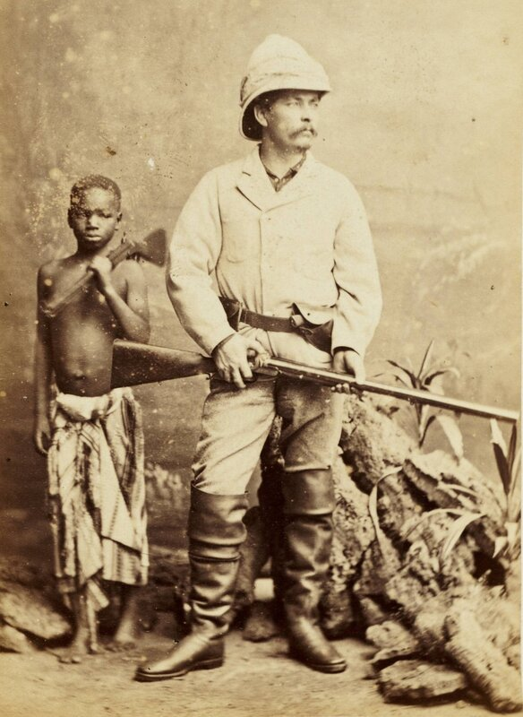 Stanley posing in London with Kalulu in the suit he wore when he found Livingstone, 1872