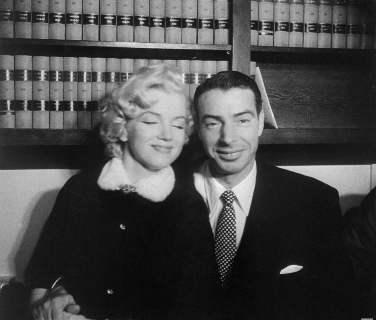 Marilyn Monroe Sitting with Joe DiMaggio