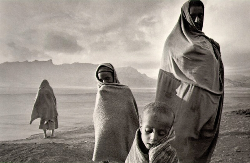 Refugees in the1984 Korem Camp, Ethiopia.Korem was the location of one of the early refugee camps of the 1984 - 1985 famine in Ethiopia, housing 35,500 children in April 1983. On 21 April, the TPLF raided the town, seizing humanitarian supplies and ta