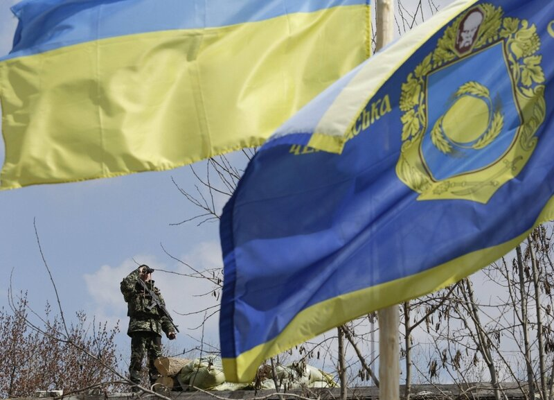 An Ukrainian border guard looks out from a base close to the Russian border near Donetsk