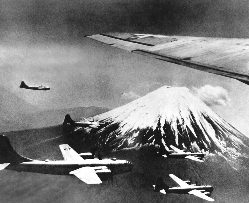 A group of B-29 bombers fly past Mount Fuji. The snowy mountain, 15 minutes from Tokyo and the highest peak in Japan, served as rendezvous point for American bombers attacking the Japanese mainland. (1945)