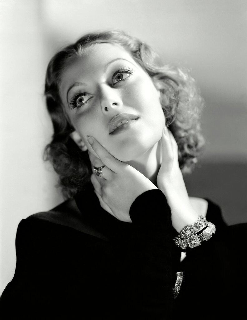 5th May 1933: American actress Loretta Young (1913 - 2000) cups her chin in her hands and affects a distracted expression.