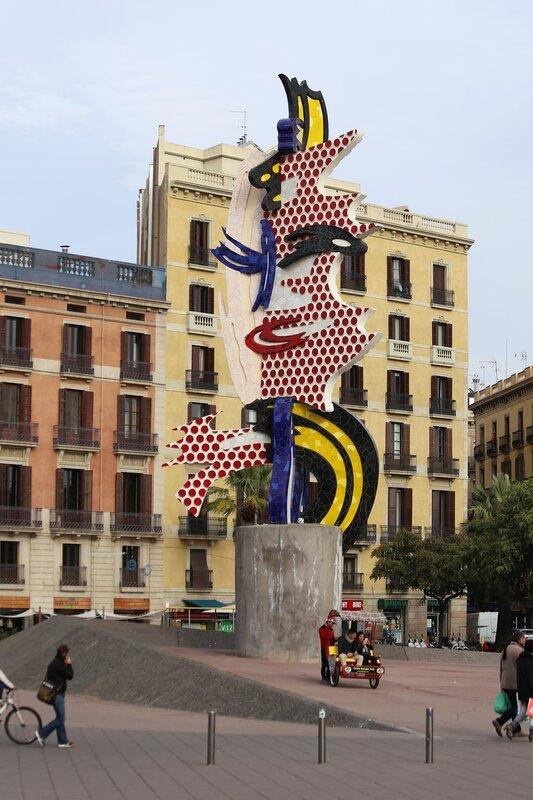 Barcelona. The promenade Moll de la Fusta. Monument Head of Barcelona (El cap de Barcelona)