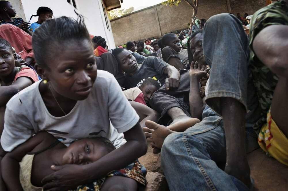 Огромное напряжение и страх на лице одной из женщин-беженок