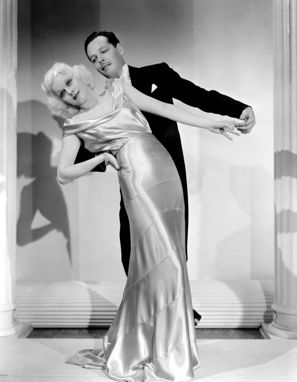 1935: Blonde actress Jean Harlow (1911 - 1937) makes her dancing debut with Carl Randall, the dance star and director in a scene from the musical 'Reckless', directed by Victor Fleming for MGM.