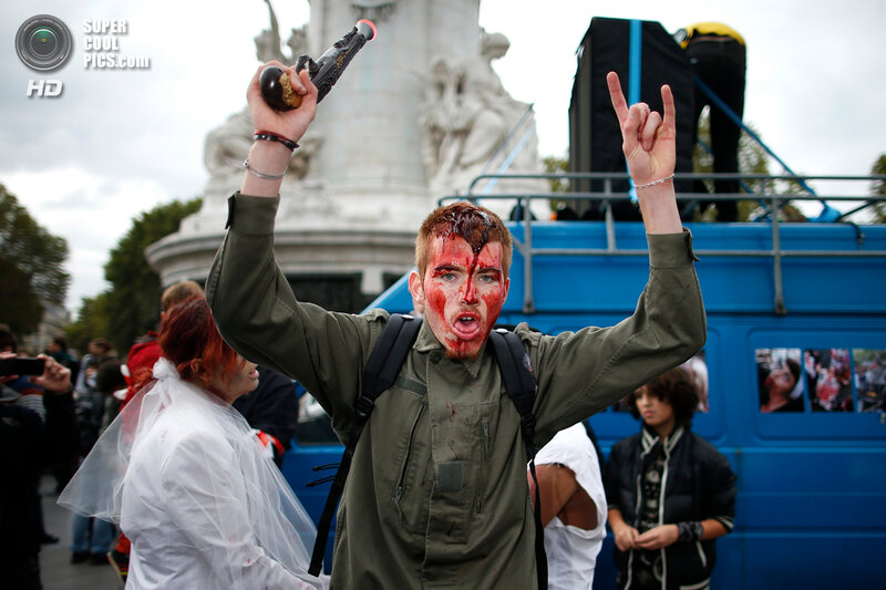 A man dressed as a zombie participates in a Zombie Walk procession in the streets of Paris