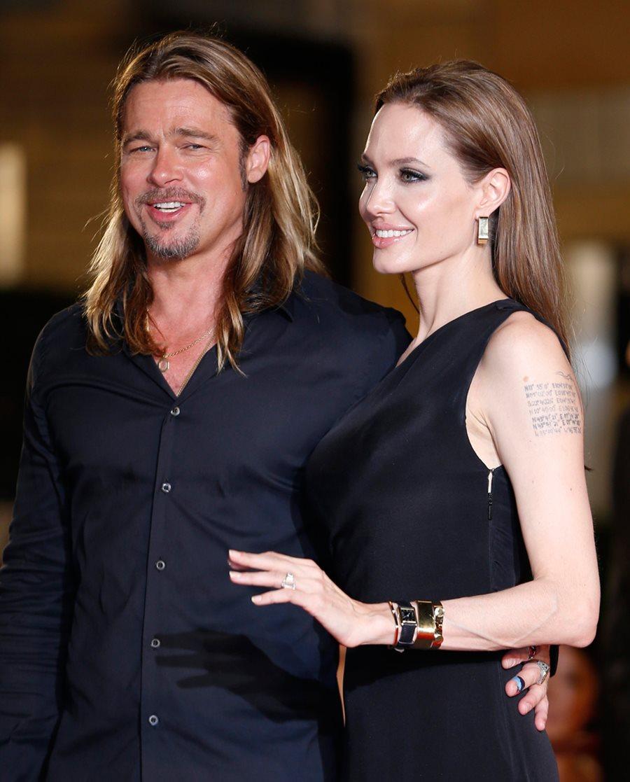 Анджелина Джоли и Брэд Питт на премьере фильма «Война миров Z» в Токио