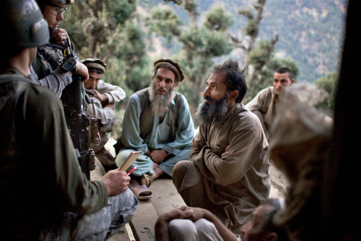 Sec4_21_0305: September, 2009 US Army soldiers question male members of a family about Taliban presence during a large aerial assault operation along the Pech River in Kunar province's Shuryak Valley. The owner of the house was suspected of harboring Tali
