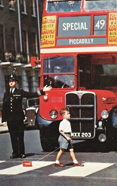 Boy crossing the road, 1960s London
