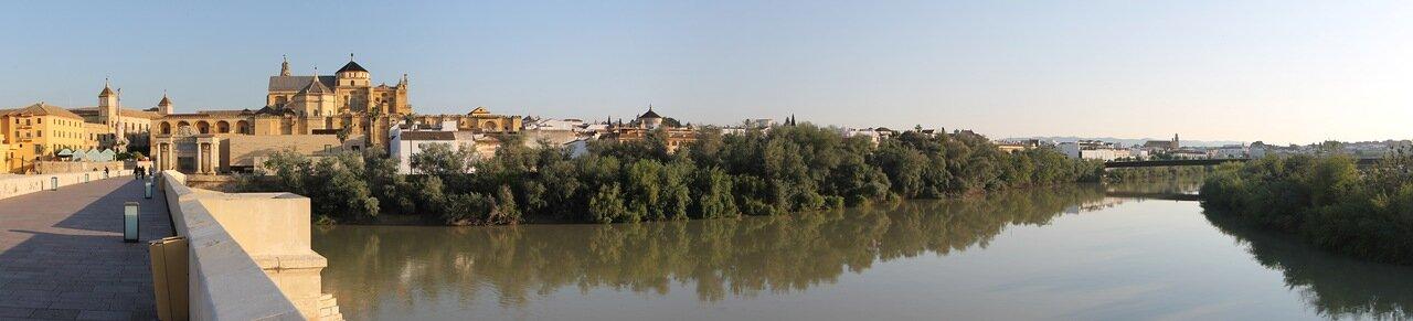 Cordoba. The Guadalquivir river, view from Puente Romano. Panorama