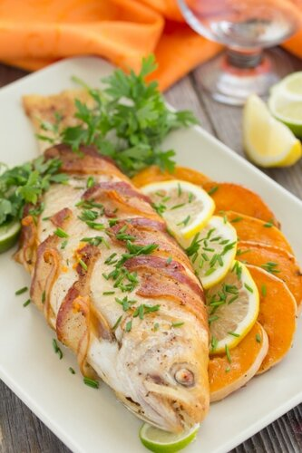 Fish (trout) baked with pumpkin and vegetables.