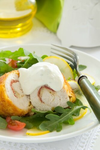 Chicken breast with salad and tartare sauce.