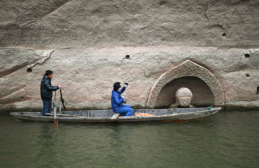 600-Year-Old Buddha Head Emerges From a Lake In China