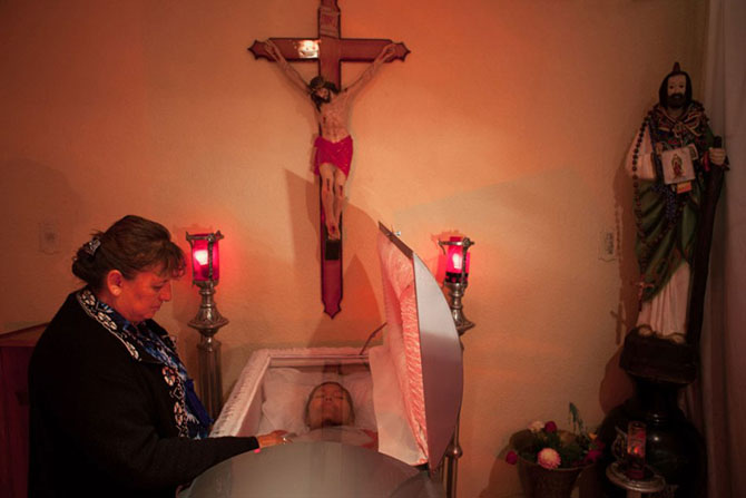 Mexico City, 2010, A sex worker, who prefers not to share her name, attends the funeral of another sex worker who died of cancer at age 64.