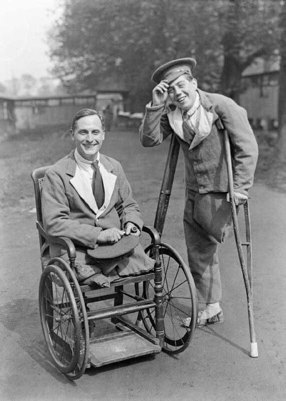 Two disabled soldiers on the grounds of the 4th London General Hospital. The original caption reads Are we downhearted. ca 1916.