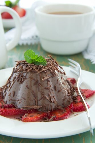 Chocolate panna cotta with strawberries and coffee.