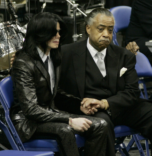 Entertainer Michael Jackson (L) is conso