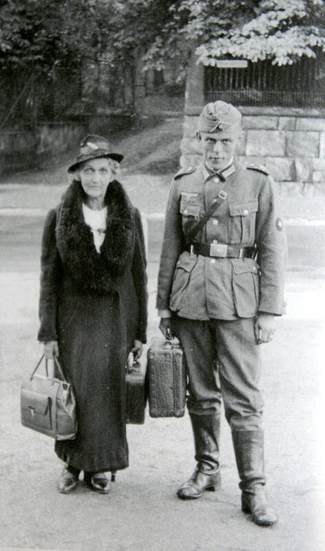 German soldier photographed with his elderly mother before departing for the front in the West, Sept. 1940