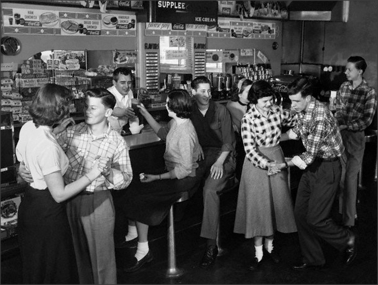Teens 1950s Teen couples showing off their moves at a local soda shop