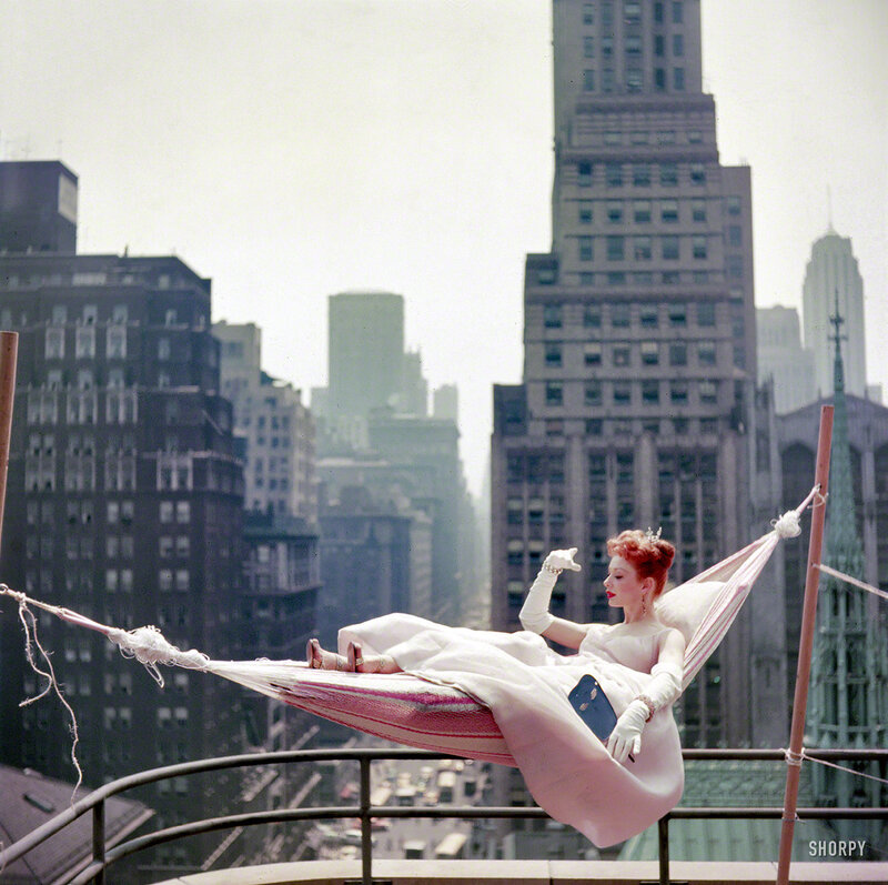 May 1953. Dancer-actress Gwen Verdon in a hammock wearing a ballgown. Color transparency from photos taken for the Look magazine assignment 'Midsummer Fantasies - How to Keep Cool in a Heat Wave'