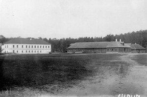 Монастырские постройки, справа - конюшни.