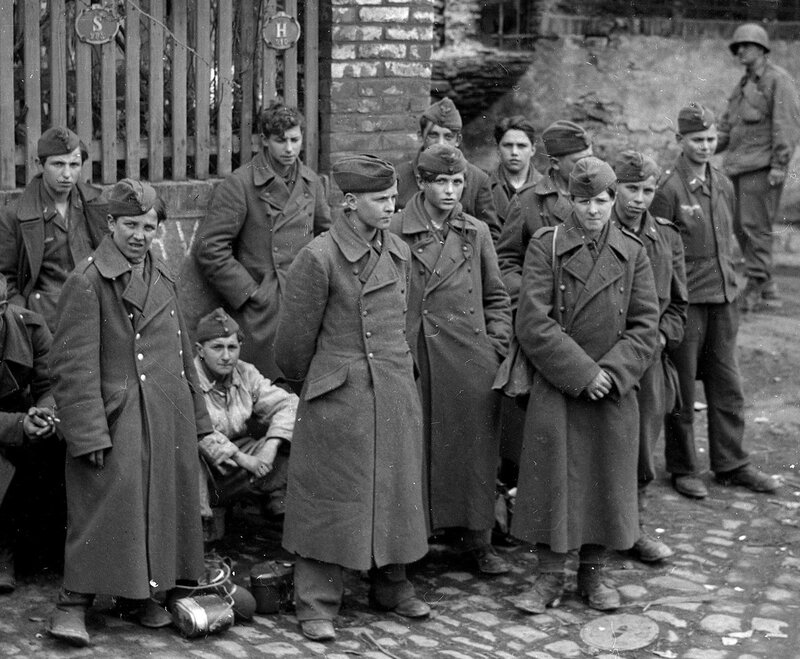 Teenage German AA gunners captured by the US 9th Armored Division at an unidentified location in Germany, April 1945. By the end of the war, most AA artillery was manned by the very young, sometimes as young as 12