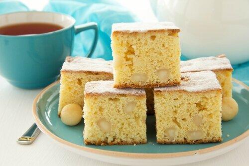 Sweet cake brownies (blondie) with macadamia nuts.