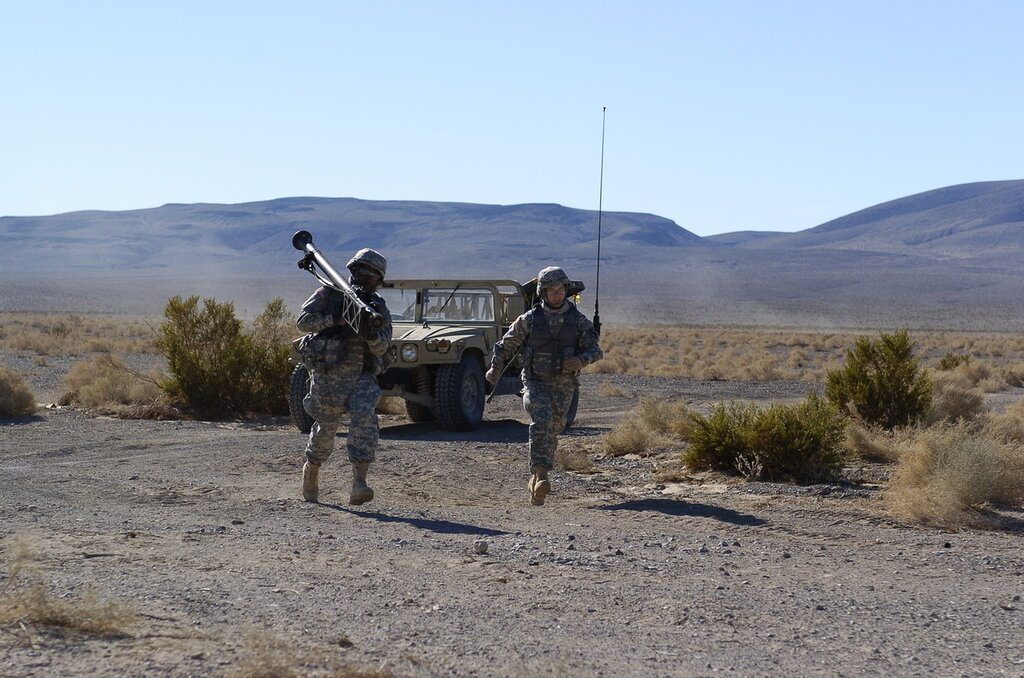 PFC Boyd and PVT Donaldson move to targeting pit with Stinger Shoulder Fired Missile System.