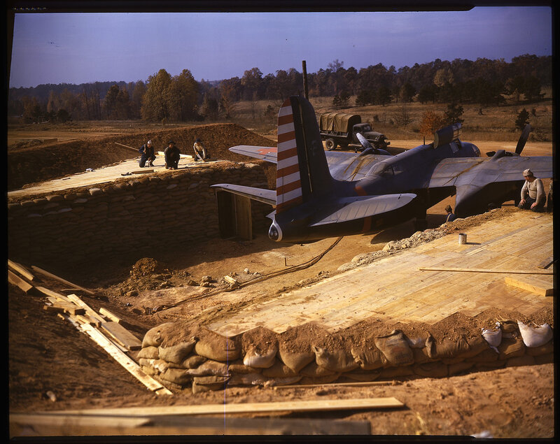 One-half right rear view of a Douglas A-20A Havoc (s/n unknown) being backed into a revetment during the Louisiana Maneuvers of 1941.  This aircraft was part of the 'red' forces.