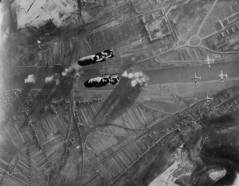 USAAF Martin B-26 Marauder bombers on the railroad bridge across the Moselle river at Trier-Pfalzel, Rhineland-Palatinate, Germany (49.778N, 6.684E). The photo was probably taken on 24 December 1944, when 69 B-26s of the 323rd and 394th Bomb Group attacke
