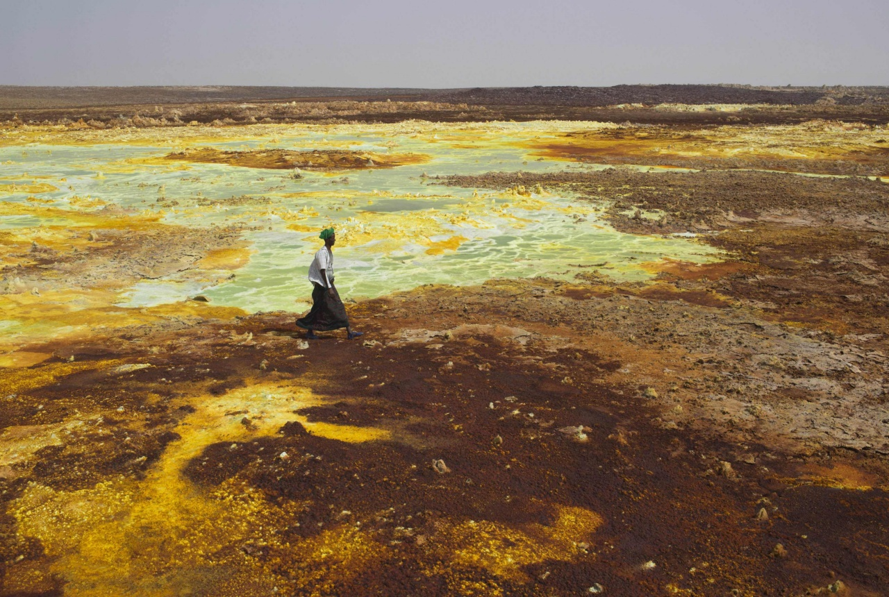 A man walks on sulphur and mineral salt formations near Dallol in the Danakil Depression