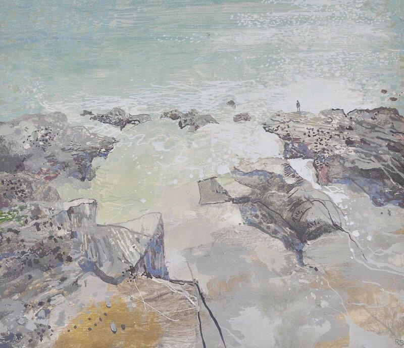 Figure on a rocky shoreline