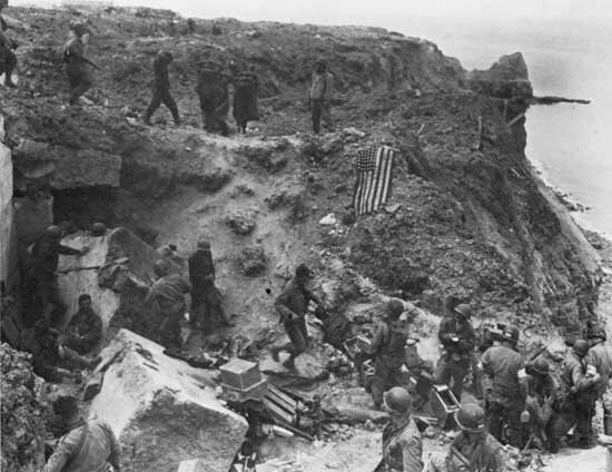American soldiers with German prisoners on Pointe Du Hoq, Normandy, 6th of june 1944